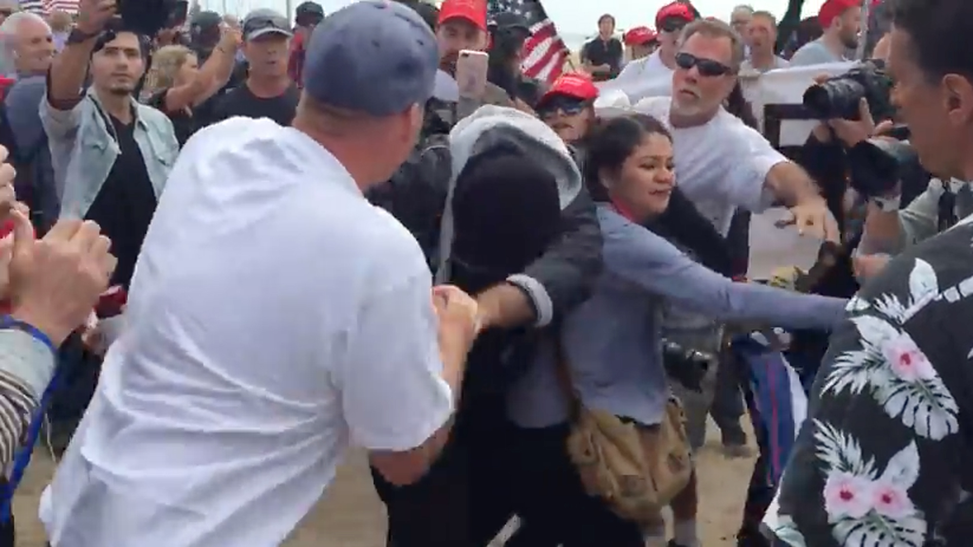 A fight broke out during a pro-Trump rally in Huntington Beach on March 25, 2017. (Credit: KTLA)
