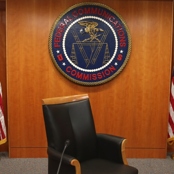 The seal of the Federal Communications Commission hangs behind the commissioner's chair inside the hearing room at the FCC headquarters Feb. 26, 2015, in Washington, D.C. (Credit: Mark Wilson/Getty Images)