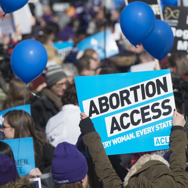 Supporters of legal access to abortion, as well as anti-abortion activists, rally outside the Supreme Court in Washington, DC, March 2, 2016, (Credit: SAUL LOEB/AFP/Getty Images)