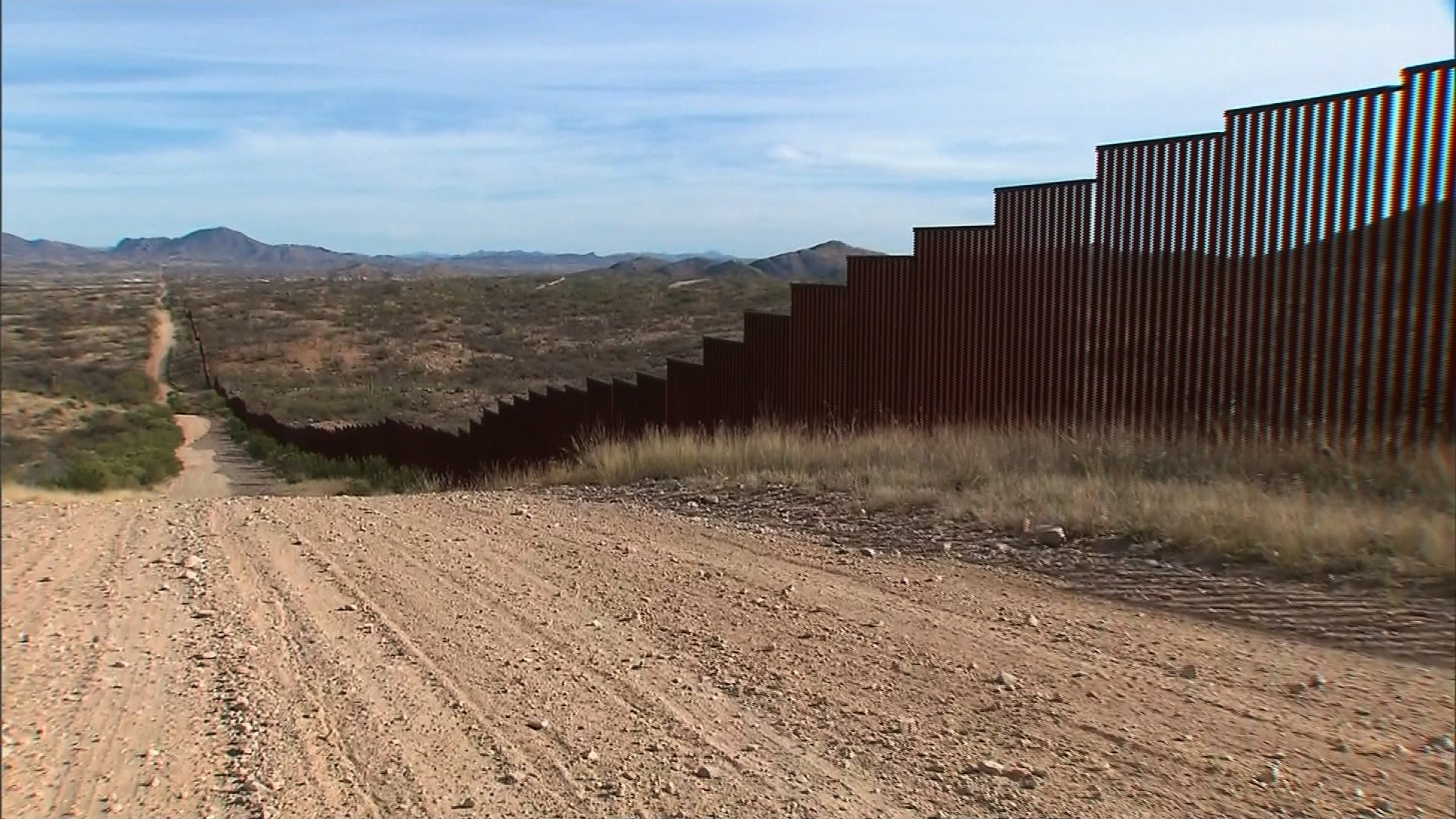 The wall along the southern border of the United States where it meets Mexico. (Credit: CNN)