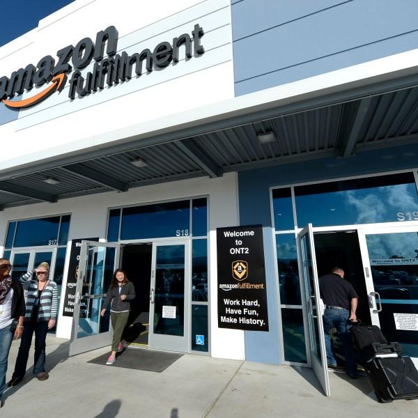 Employees arrive at Amazon's San Bernardino fulfillment center Oct. 29, 2013, in San Bernardino. (Credit: Kevork Djansezian/Getty Images)