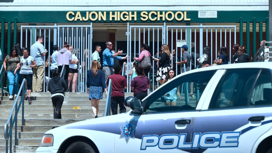 A police vehicle is visible in front of Cajon High School in San Bernardino on April 10, 2017, following a shooting in a classroom at North Park Elementary School nearby in San Bernardino. (Credit: Frederic J. Brown/AFP/Getty Images)