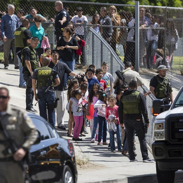 Students leave North Park Elementary School in San Bernardino amid a heavy police presence following a shooting on April 10, 2017. (Credit: Gina Ferazzi/Los Angeles Times)