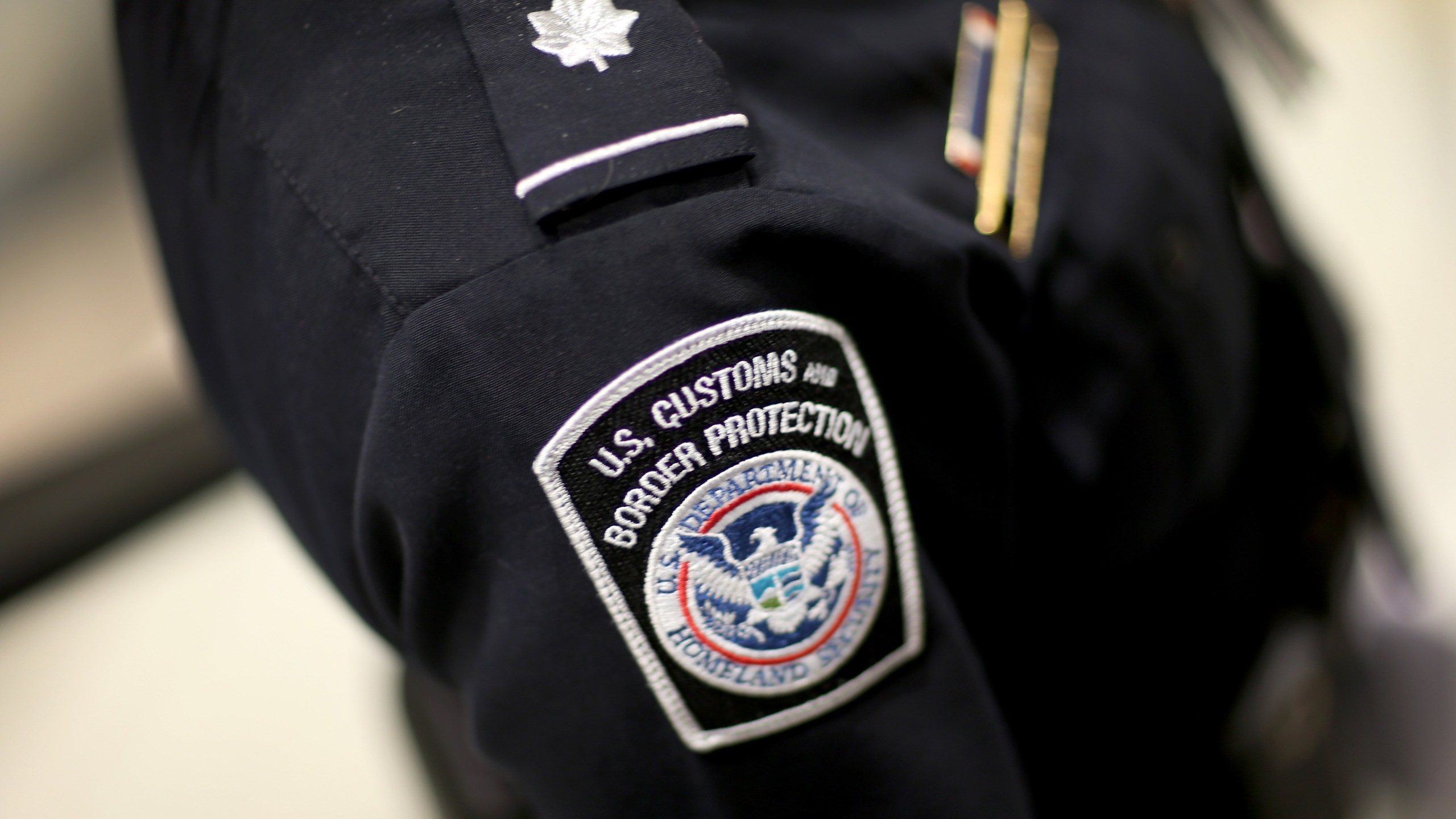 A U.S. Customs and Border Protection officer's patch is seen as they unveil a new mobile app for international travelers arriving at Miami International Airport on March 4, 2015. (Credit: Joe Raedle / Getty Images)