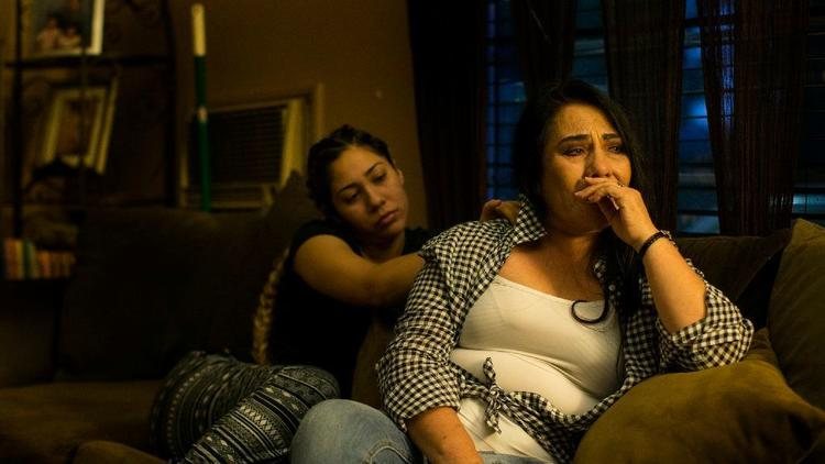 Guadalupe Plascencia, right, is consoled by her daughter Mahria Torres as she recounts her ordeal of being arrested by Ontario police, jailed and then transferred to ICE custody, despite the fact she is a U.S. citizen. (Credit: Gina Ferazzi / Los Angeles Times)