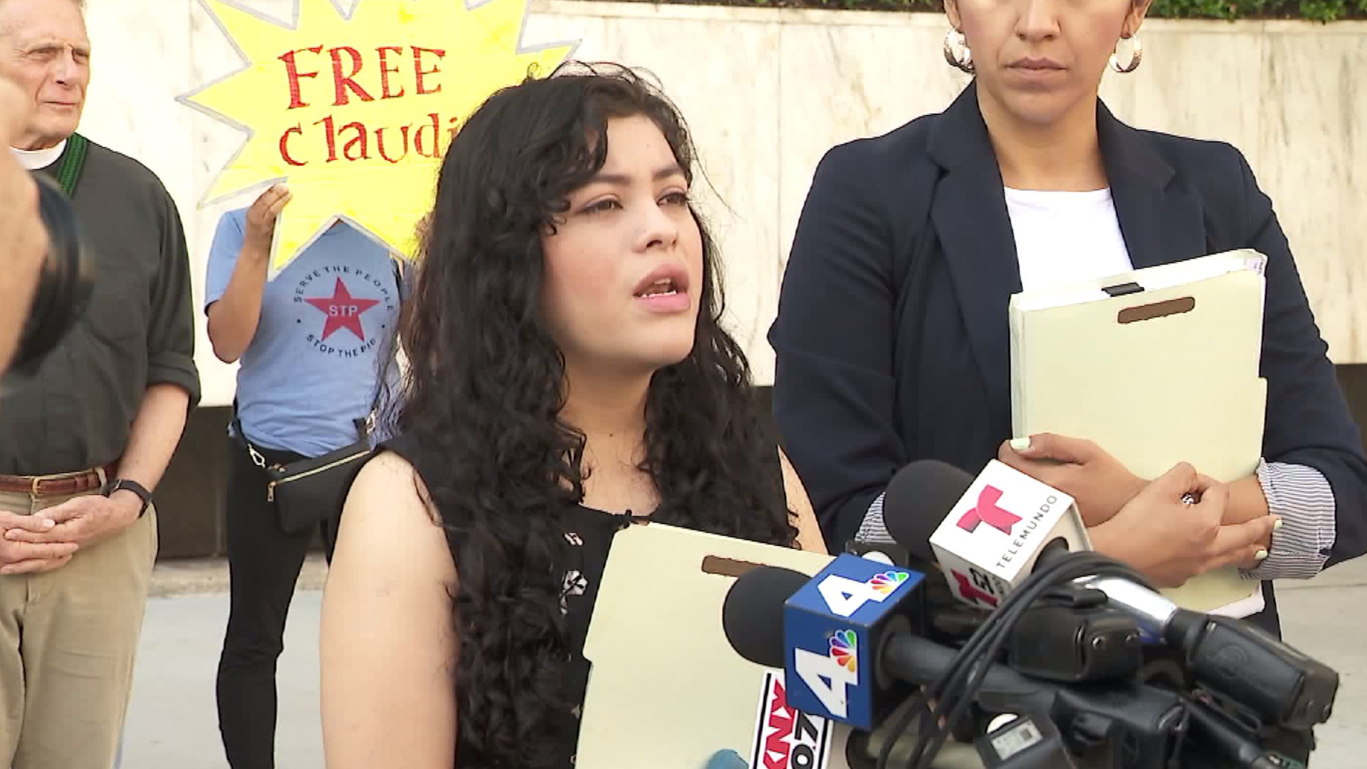 Claudia Rueda speaks in downtown L.A. about her attorney's of her application for DACA on June 19, 2017. (Credit: KTLA)