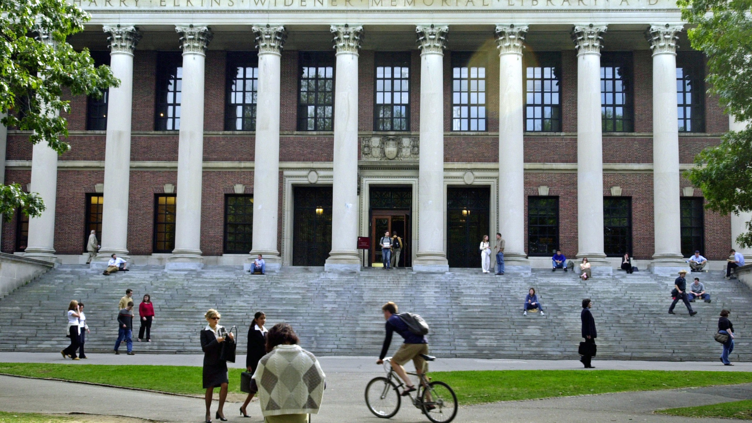 Students pass in front of Harvard's Widener Library in a file photo. (Credit: William B. Plowman/Getty Images)