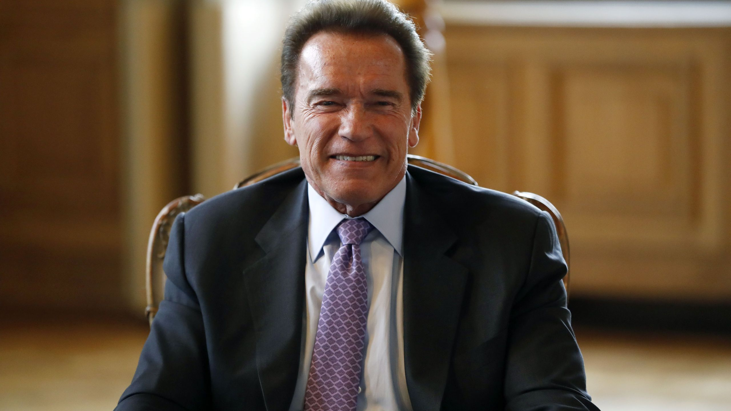 Arnold Schwarzenegger meets with the mayor of Paris on April 28, 2017, in Paris to sign a convention for cooperation between the C40 Cities Climate Leadership Group and the R20 organization. (Credit: PATRICK KOVARIK/AFP/Getty Images)