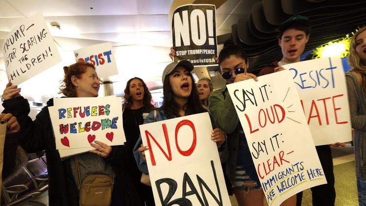 Demonstrators gather at Tom Bradley International Terminal at LAX in late January 2017 to protest President Trump's travel ban. (Genaro Molina / Los Angeles Times)