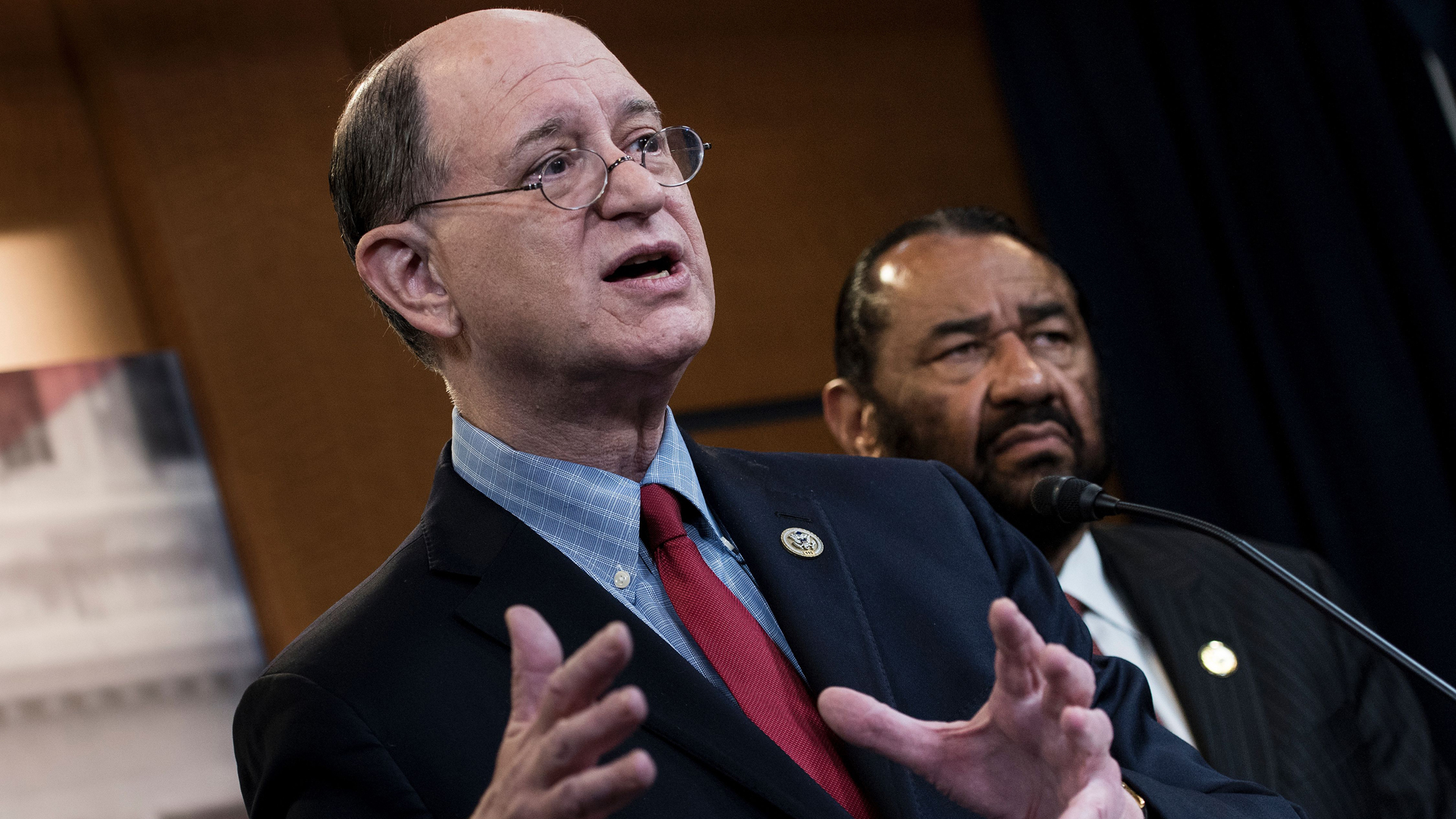 U.S. Representative Brad Sherman, left, Democrat of California, and U.S. Representative Al Green, Democrat of Texas, take questions about articles of impeachment for U.S. President Donald Trump during a press conference on Capitol Hill June 7, 2017. (Credit: Brendan Smialowski / AFP / Getty Images)