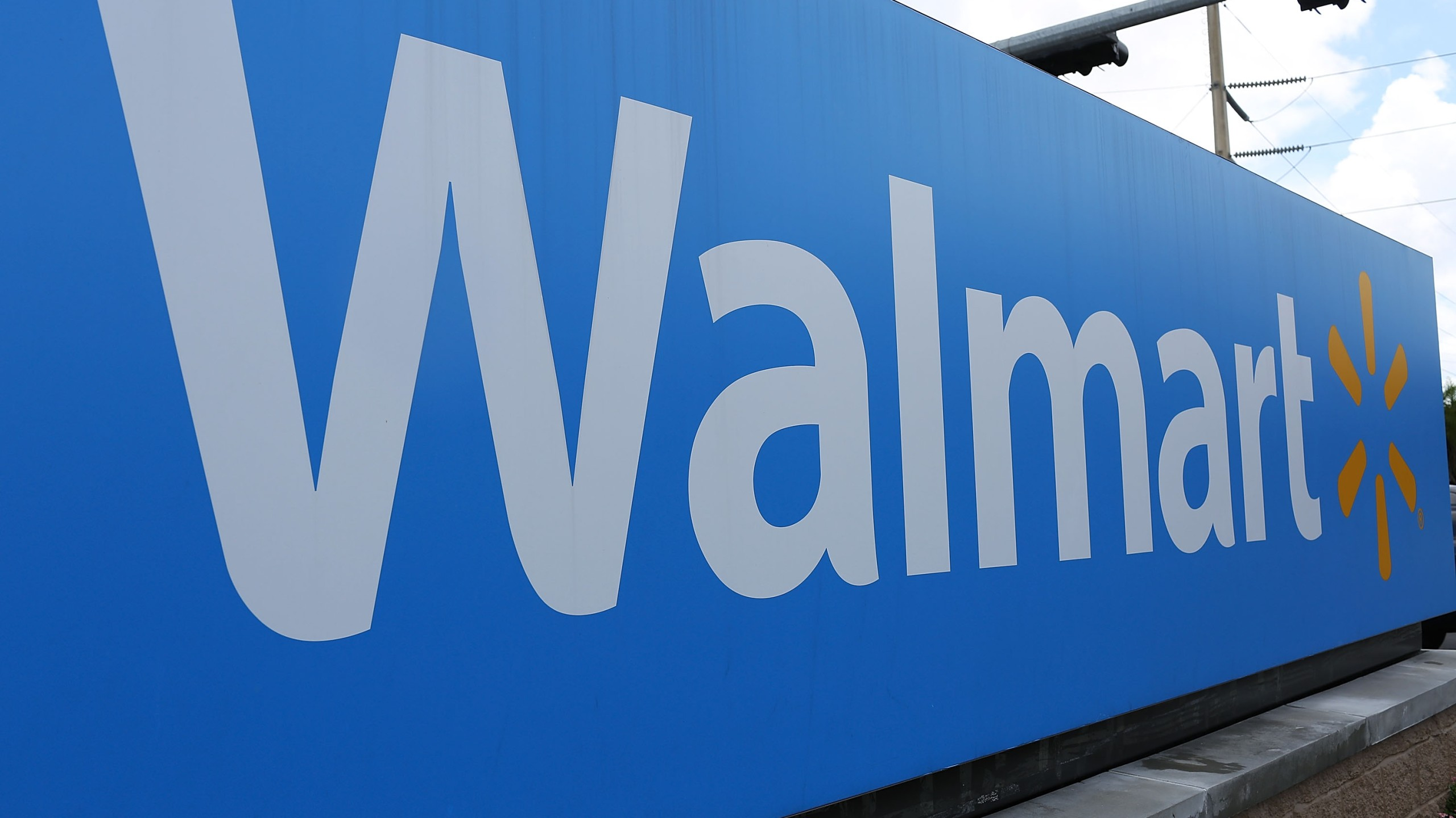 A Walmart sign is seen on August 18, 2015 in Miami, Florida. (Credit: Joe Raedle/Getty Images)