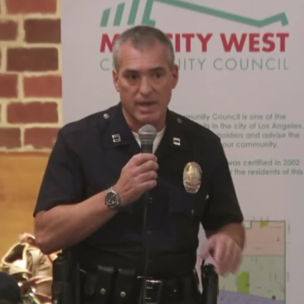 A police officer is seen speaking at the Fairfax meeting on Wednesday night intended to combat sexual assaults in the area. (Credit: KTLA)