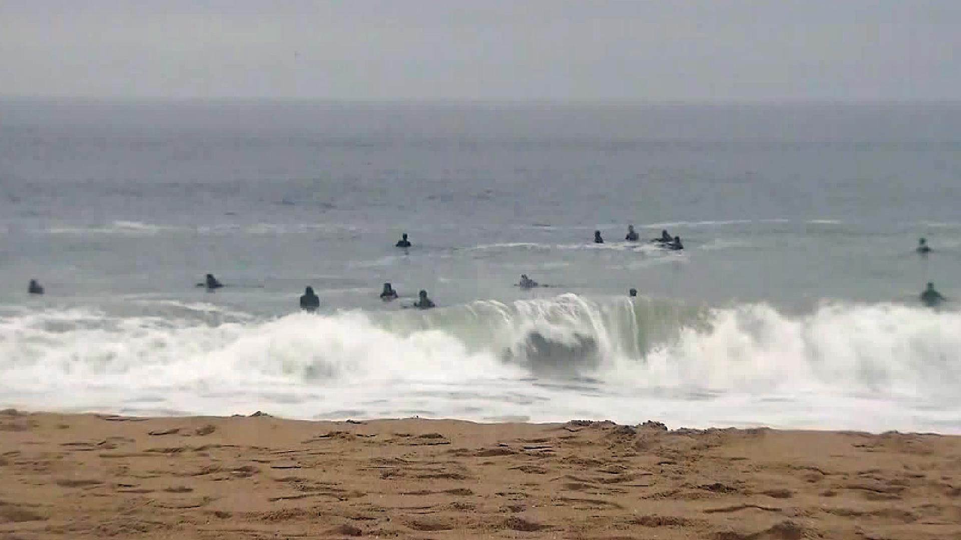 Surfers are seen off Newport Beach on July 12, 2017. (Credit: KTLA)