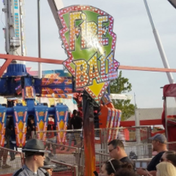 "The ""Fireball,"" which can be seen in this image, is the ride that malfunctioned and left one person dead and six injured on Wednesday. (Credit: Justin Eckard via Twitter)"
