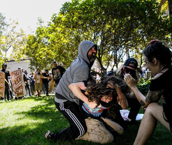 Demonstrators beat a man Sunday at Martin Luther King Jr. Civic Center Park in Berkeley. (Credit: Marcus Yam / Los Angeles Times)