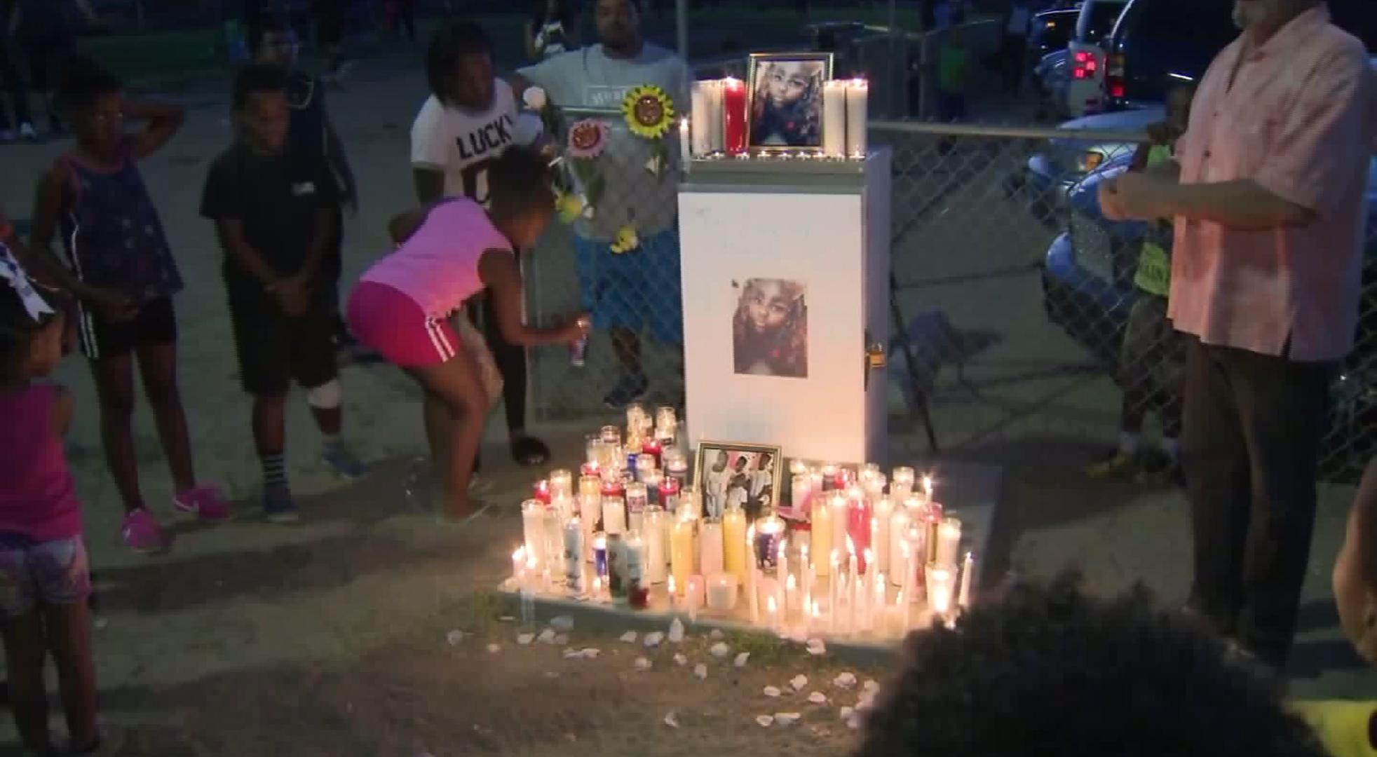 Candles surround a photo of Makiya Walls at a vigil in her honor on Aug. 10, 2017. (Credit: KTLA)