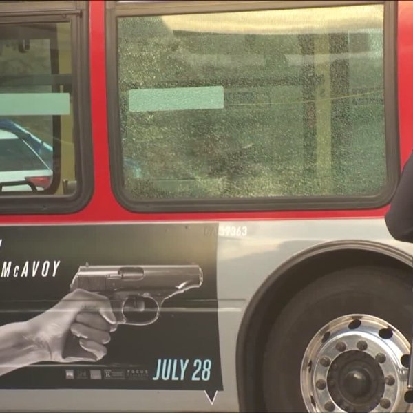 Police are shown on the scene of a bus window shattered by a gunshot in South L.A. on August 3, 2017. (Credit: KTLA)