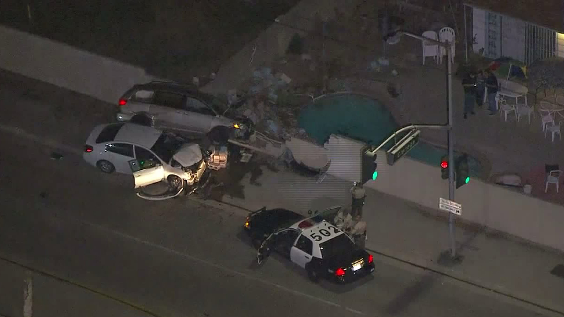 Two cars involved in a crash following a police pursuit in Covina on Friday night are seen heavily damaged. (Credit: KTLA)