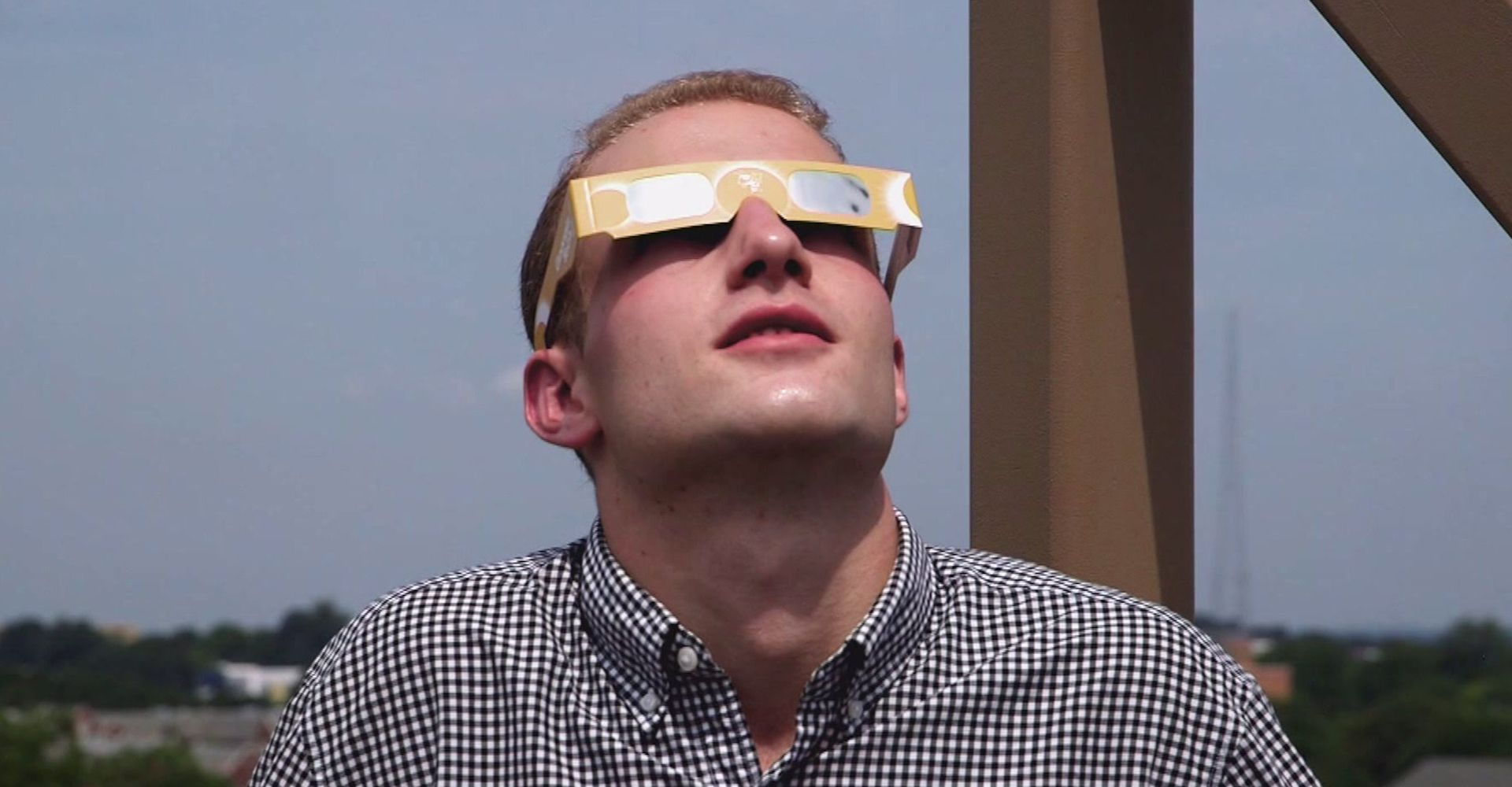 A man wears special eyewear for watching the solar eclipse. (Credit: KTLA)