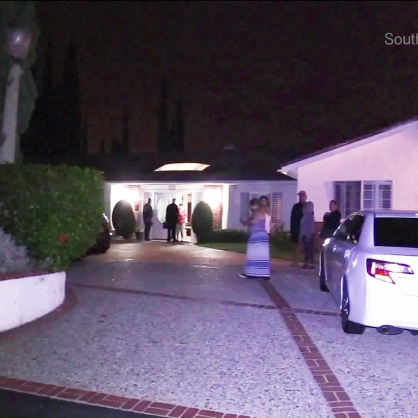 Police respond to a home-invasion robbery in Fullerton. (Credit: Southern Counties News)