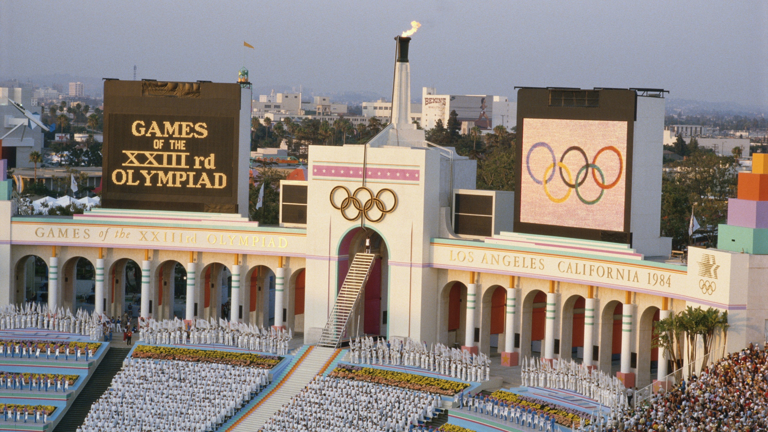 An overview of the opening ceremony at the Los Angeles Coliseum during the lighting of the Olympic flame of the 1984 Summer Olympics. (Credit: Getty Images)