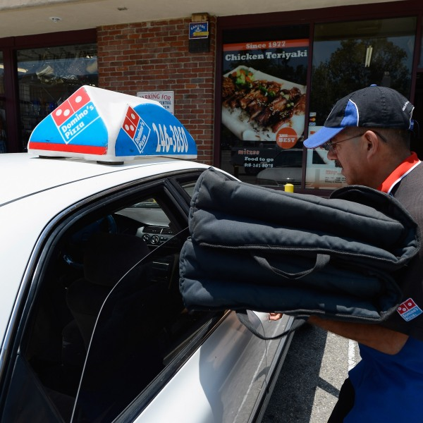 A Domino's Pizza delivery man sets out for delivery on June 21, 2012 in Glendale, California. (Credit: Kevork Djansezian/Getty Images)