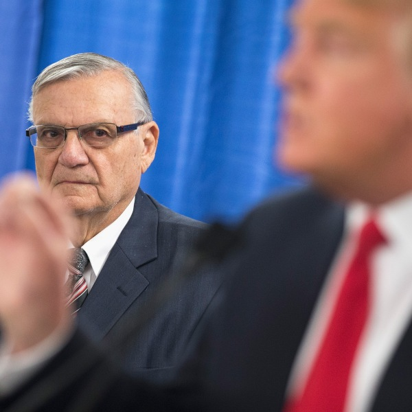 Sheriff Joe Arpaio of Maricopa County, Arizona, listens as Republican presidential candidate Donald Trump speaks to the press prior to a rally on Jan. 26, 2016, in Marshalltown, Iowa. (Credit: Scott Olson/Getty Images)