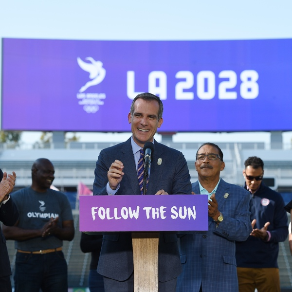 Los Angeles Mayor Eric Garcetti speaks at the podium as he announces a deal has been reached with the International Olympic Committee to host the 2028 Summer Olympics. (Credit: Kevork Djansezian/Getty Images)