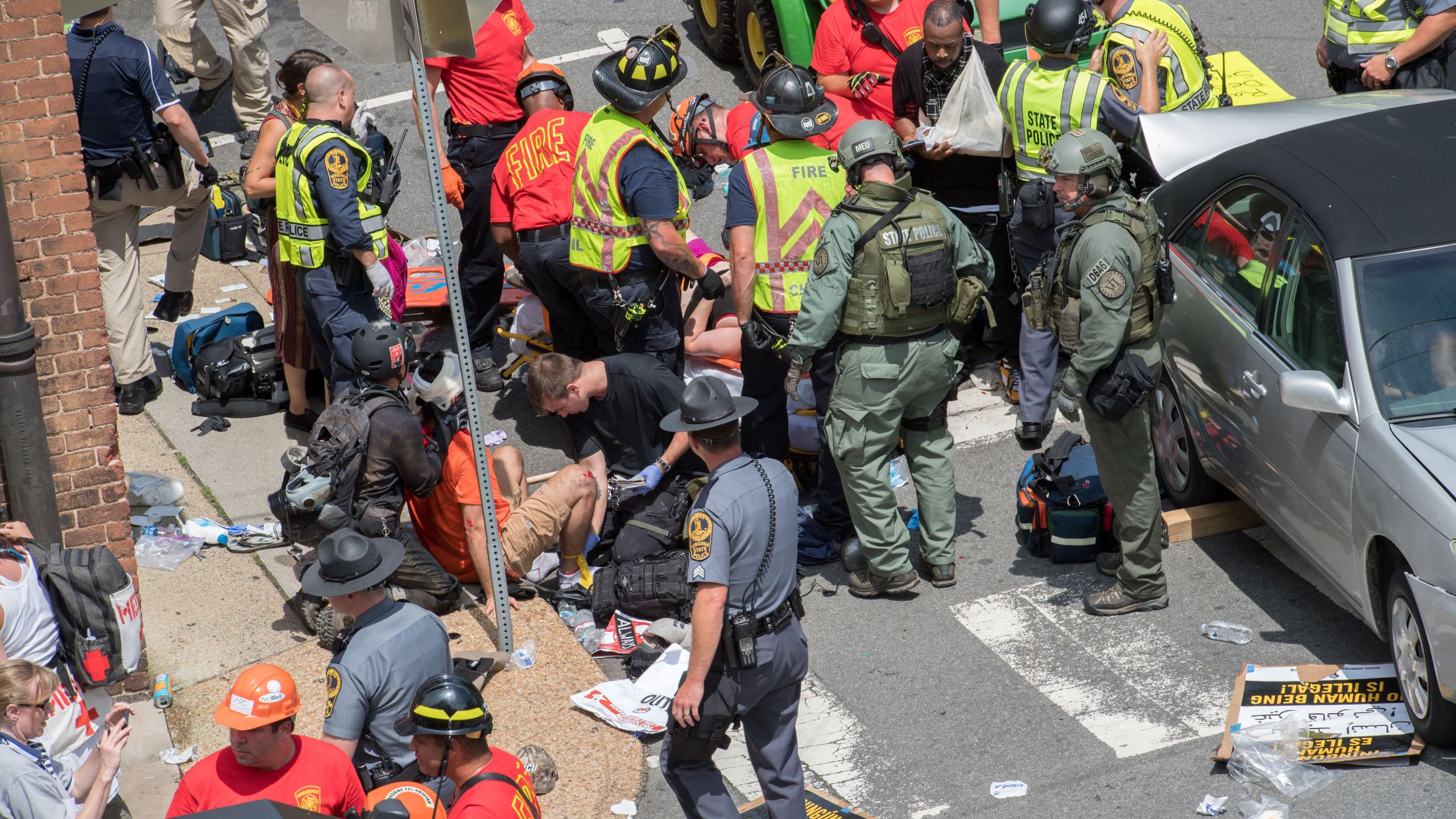 People receive first-aid after a car ran into a crowd of protesters in Charlottesville, Virginia, on Aug. 12, 2017. (Credit: Paul J. Richards / AFP / Getty Images)