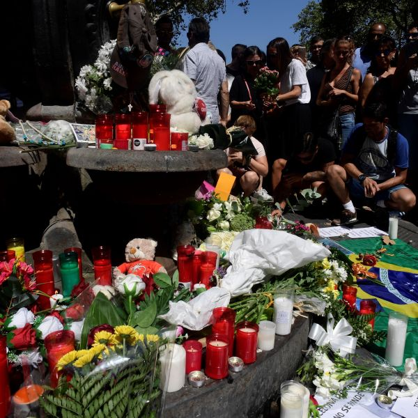 People leave stuffed toys, candles, messages, flowers and other objects at the Canaletas fountain on the Rambla boulevard for the victims of the Barcelona attack. (Credit: JAVIER SORIANO/AFP/Getty Images)