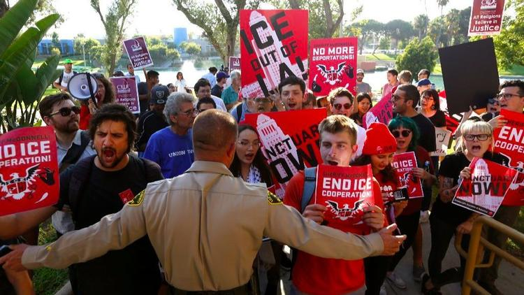 Activists rally outside the East Los Angeles sheriff's station in support of so-called sanctuary state legislation. (Credit: Genaro Molina / Los Angeles Times)