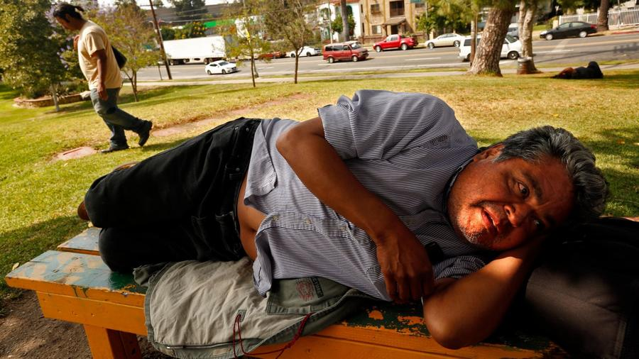 """Timoteo Arevalos, 55, in Boyle Heights' Hollenbeck Park in June. """"This is home,"""" said Arevalos, who grew up nearby. (Credit: Genaro Molina / Los Angeles Times)"""