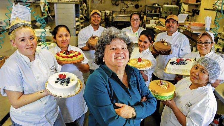 Betty Porto, center, is one of three siblings who run Porto's Bakery & Cafe, the family business founded by their Cuban emigre parents. (Credit: Irfan Khan / Los Angeles Times)