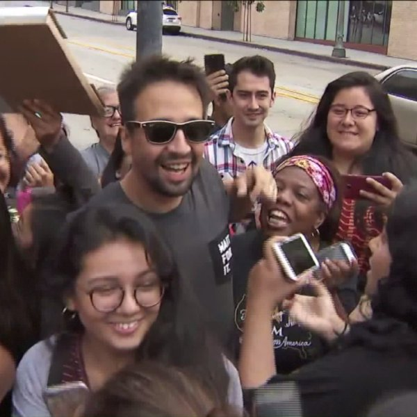 Lin-Manuel Miranda poses with fans outside the Pantages in Hollywood on Aug. 16, 2017. (Credit: KTLA)
