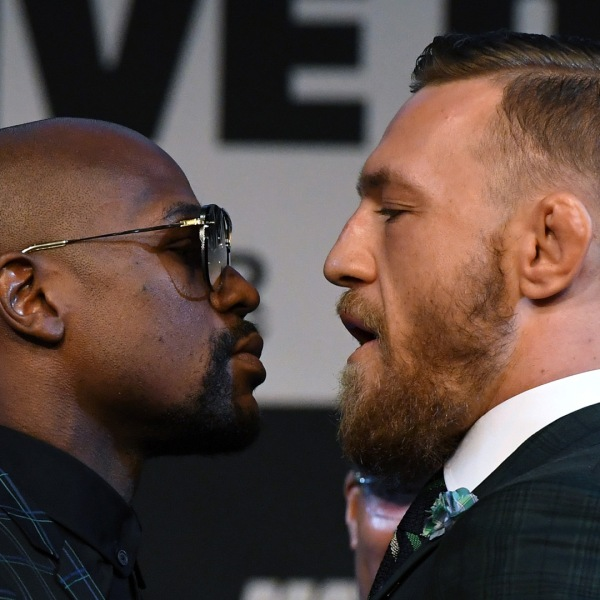Boxer Floyd Mayweather Jr., left, and UFC lightweight champion Conor McGregor, right, face off during a news conference at the KA Theatre at MGM Grand Hotel & Casino on August 23, 2017 in Las Vegas. (Credit: Ethan Miller/Getty Images)