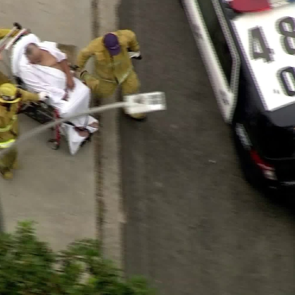 A man was rushed to the hospital after being shot during a home-invasion in the Mid-Wilshire area on Aug. 23, 2017. (Credit: KTLA)
