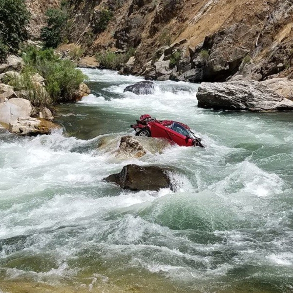Police in Fresno have been working for two weeks to try and retrieve the vehicle, which is stuck in the middle of a fast-moving part of Kings River. (Credit: Fresno County Sheriff's Office)