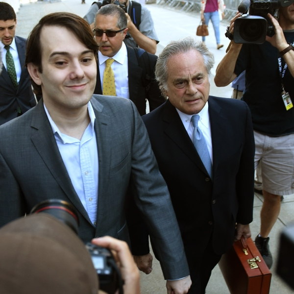 """Martin Shkreli, the former Turing Pharmaceuticals executive who became known as """"Pharma Bro"""" arrives for the first day of jury selection in his federal securities fraud trial June 26, 2017, at U.S. District Court Eastern District of New York in Brooklyn. At right is his lawyer Ben Brafman. (Credit: TIMOTHY A. CLARY/AFP/Getty Images)"""
