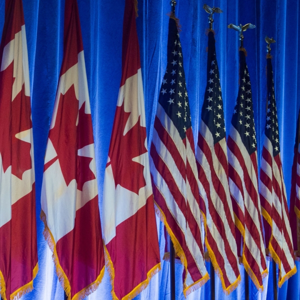 The flags of Canada, the United States and Mexico line the stage before the start of the negotiations for the modernization of NAFTA, Aug. 16, 2016, in Washington, DC. (Credit: Paul J. Richards / AFP / Getty Images)