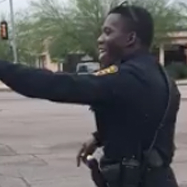 A Tucson Police officer is seen entertaining passing motorists. (Credit: Tucson Police Department)