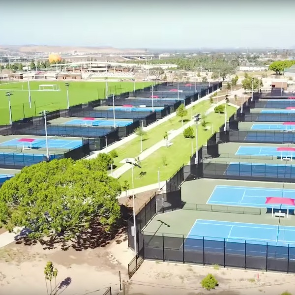 A still from a city of Irvine promotional video of the aerial view of the tennis courts at the Orange County Great Park Sports Park.