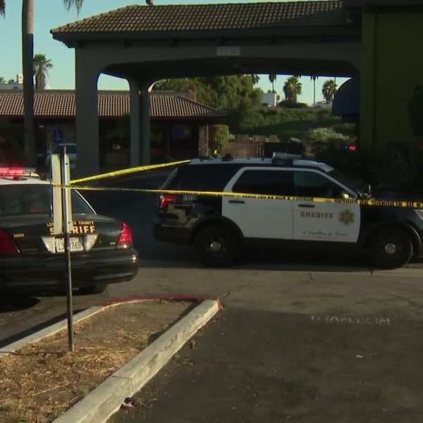 Police cordon off an area of a hotel in Artesia to investigate a suspicious death on Sept. 29, 2017. (Credit: KTLA)