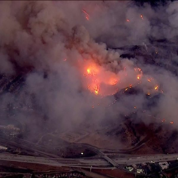 The Canyon Fire burns close to homes at the border with Corona and Anaheim on Sept. 25, 2017. (Credit: KTLA)