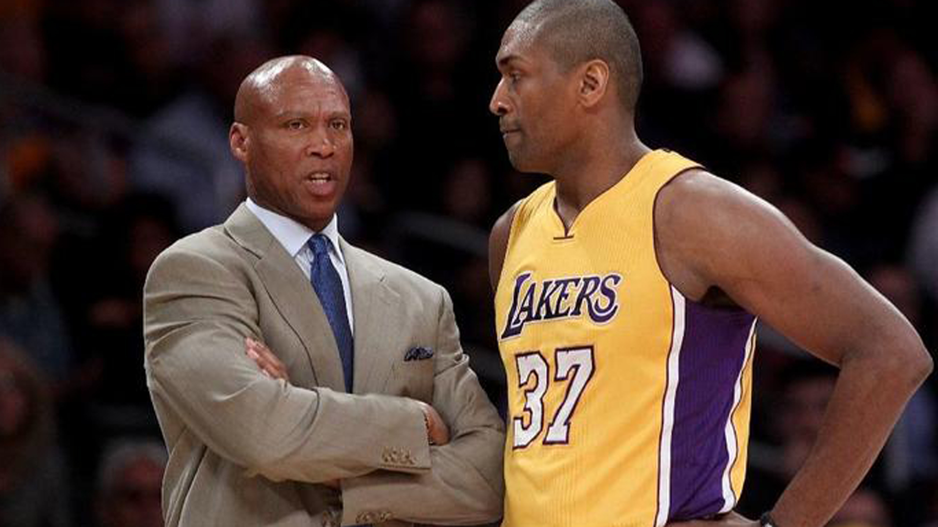 Former Lakers coach Byron Scott speaks with player Metta World Peace during a game against the Orlando Magic in March 2016 at Staples Center. (Luis Sinco/Los Angeles Times)