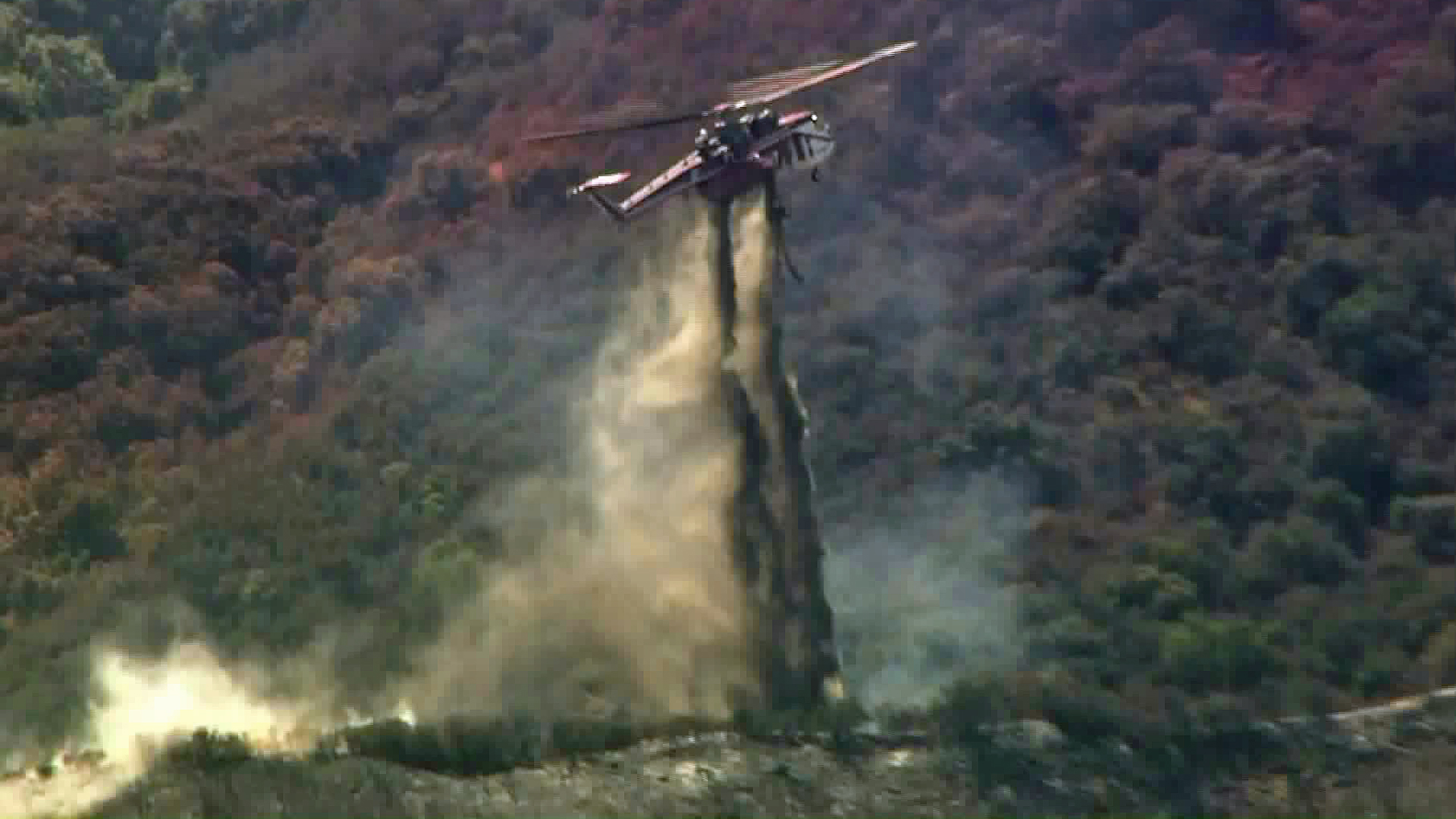 A helicopter helps battle the Canyon Fire near Corona. (Credit: KTLA)