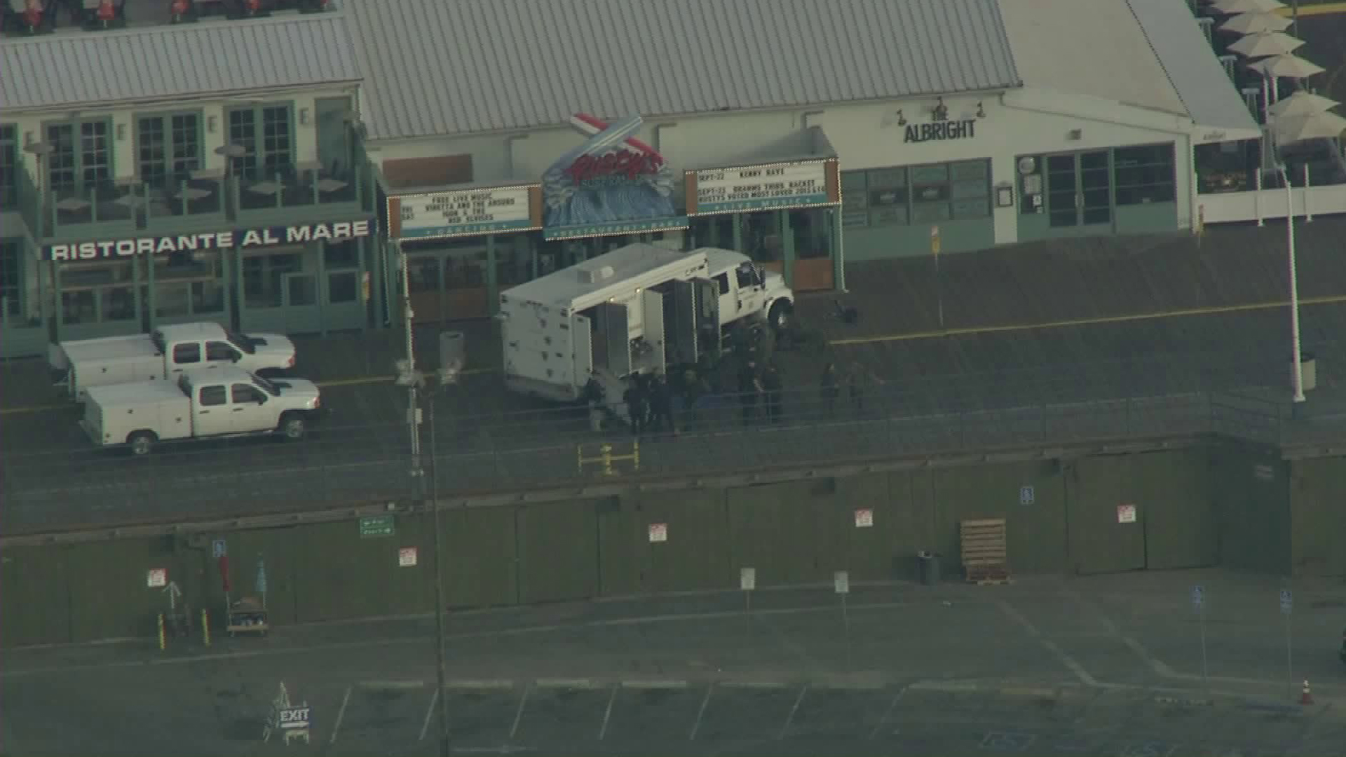 Officials respond to a bomb threat at the Santa Monica Pier on Sept. 11, 2017 and pedestrian traffic was cleared from the area. (Credit: KTLA)