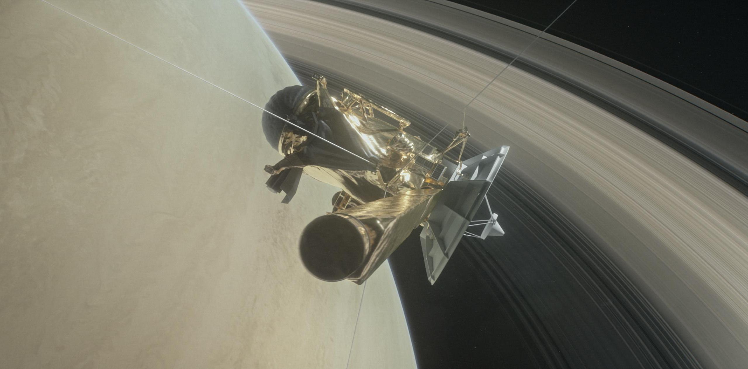 This illustration shows NASA's Cassini spacecraft about to make one of its dives between Saturn and its innermost rings as part of the mission's grand finale. (Credit: NASA)