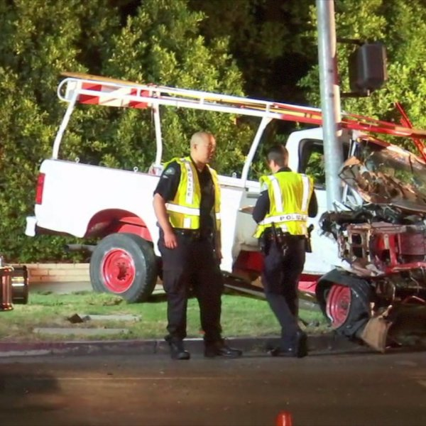 A pickup truck that crashed into an SUV is shown Sept. 6, 2017, in Hancock Park. (Credit: ANG News)