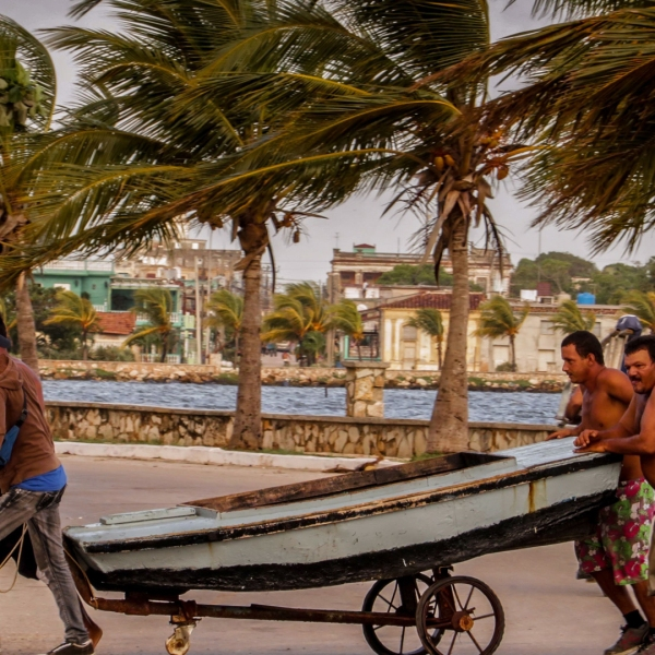 Cubans carry a boat out of the sea on Sept. 8, 2017, ahead of the arrival of Hurricane Irma in the town of Caibarien. (Credit: Adalberto Roque/AFP/Getty Images)