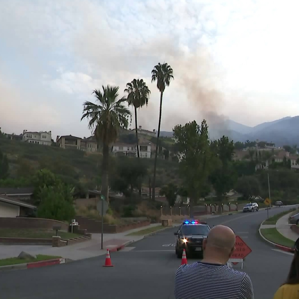 Burbank residents wait near a blocked street to hear if evacuations in their neighborhood are lifted during the La Tuna Fire on Sept. 2, 2017. (Credit: KTLA)